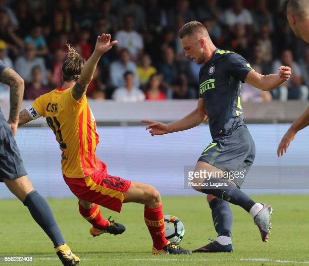 Andrea Coasta of Benevento competes for the ball with Milan Skriniar of Inter during the Serie A match between Benevento Calcio and FC Internazionale...