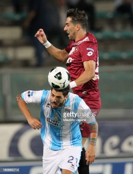 Andrea Cocco of Reggina competes for the ball in air with Raffaele Schiavi of Pescara during the Serie B match between Reggina Calcio and Pescara...