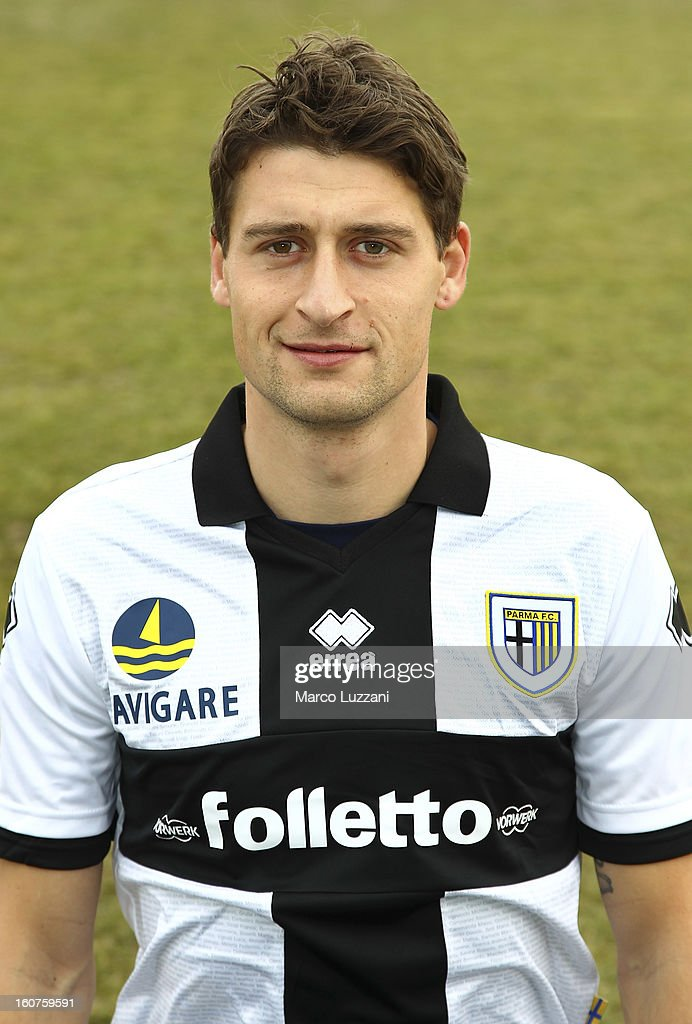 <a gi-track='captionPersonalityLinkClicked' href=/galleries/search?phrase=Andrea+Coda&family=editorial&specificpeople=660942 ng-click='$event.stopPropagation()'>Andrea Coda</a> of Parma FC poses with the club shirt during new signings official portraits at the club's training ground on February 5, 2013 in Collecchio, Italy.