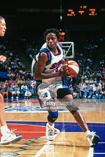 Andrea Congreaves of the Charlotte Sting handles the ball against the New York Liberty on July 17 1997 at Charlotte Coliseum in Charlotte North...