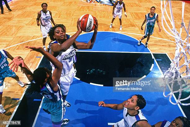 Andrea Congreaves of the Orlando Miracle drives to the basket against the Charlotte Sting on July 27 1999 at the Amway Center in Orlando Florida NOTE...