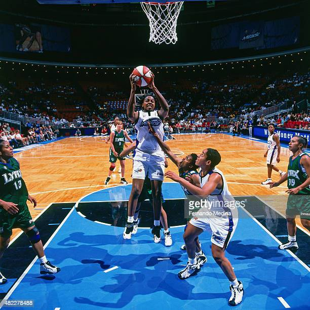 Andrea Congreaves of the Orlando Miracle grabs the rebound against the Minnesota Lynx on July 17 1999 at the Amway Center in Orlando Florida NOTE TO...