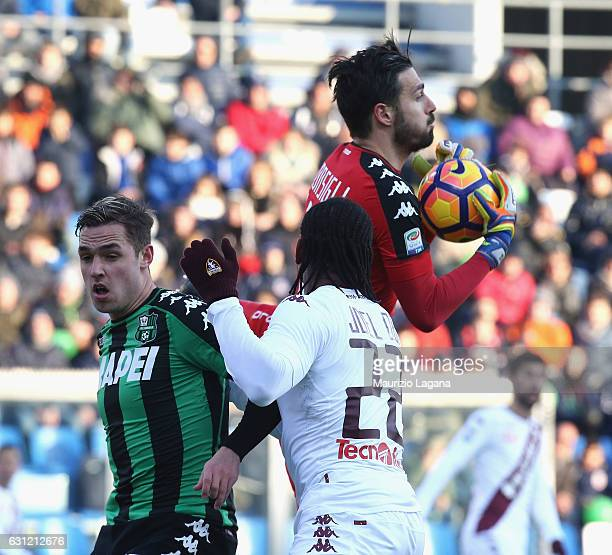 Andrea Consigli of Sassuolo competes for the ball with Joel Obi of Torino during the Serie A match between US Sassuolo and FC Torino at Mapei Stadium...