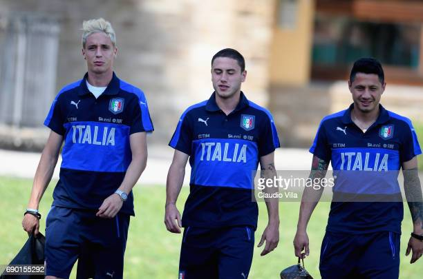 Andrea Conti Davide Calabria and Gianluca Lapadula of Italy look on during the training session at Coverciano at Coverciano on May 30 2017 in...