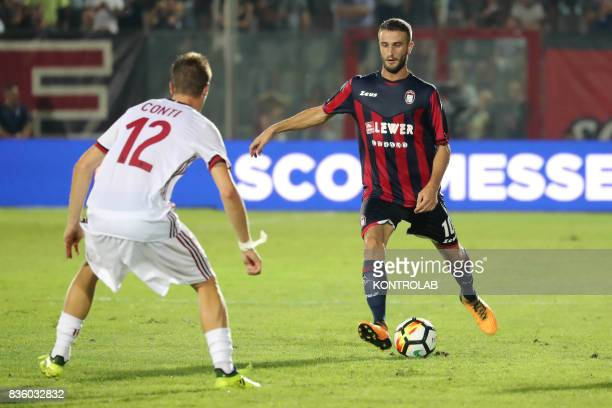 Andrea Conti defender Milan and Andrea Barberis midfielder of Crotone during the Serie A match between FC Crotone v AC Milan Milan won 30