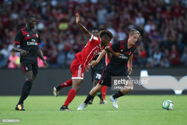 Andrea Conti of AC Milan competes for the ball with Kingsley Coman of FC Bayern during the 2017 International Champions Cup China match between FC...