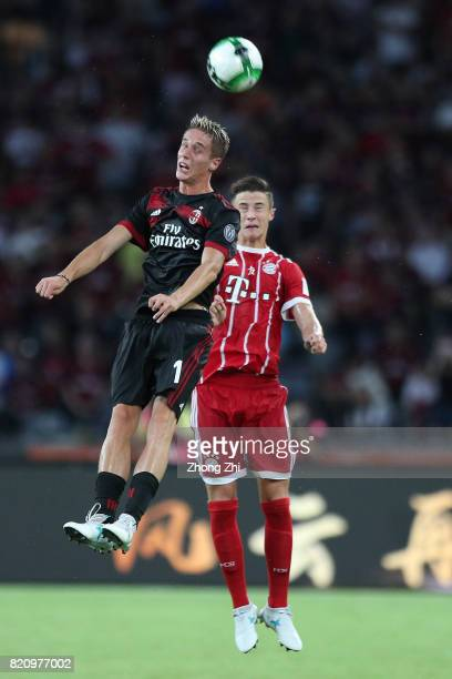 Andrea Conti of AC Milan in action against Marco Friedl of FC Bayern Muenchen during the 2017 International Champions Cup football match between AC...