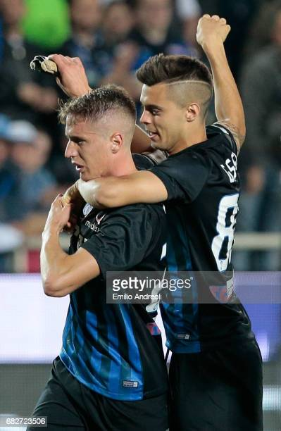 Andrea Conti of Atalanta BC celebrates the qualification at UEFA Europa League 2017/18 with his teammate Alberto Grassi at the end of theduring the...