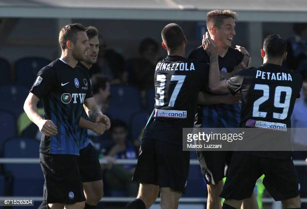 Andrea Conti of Atalanta BC celebrates with his teammates after scoring the opening goal during the Serie A match between Atalanta BC and Bologna FC...