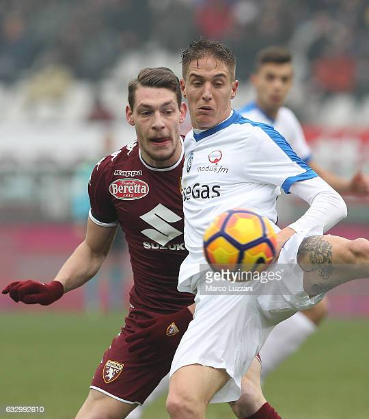 Andrea Conti of Atalanta BC competes for the ball with Andrea Belotti of Torino FC during the Serie A match betweenFC Torino and Atalanta BC at...