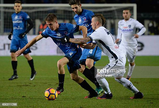 Andrea Conti of Atalanta BC competes with Marcel Buchel of Empoli FC during the Serie A match between Atalanta BC and Empoli FC at Stadio Atleti...