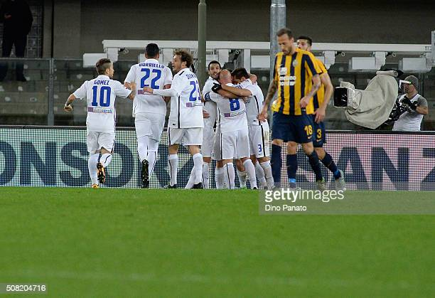 Andrea Conti of Atalanta BC is mobbed by team mates after scoring his opening goal during the Serie A match between Hellas Verona FC and Atalanta BC...