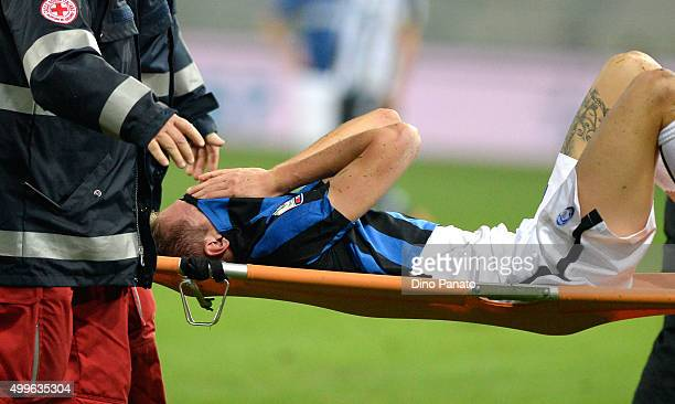 Andrea Conti of Atalanta BC is stretchered off with an injury during the TIM Cup match between Udinese Calcio and Atalanta BC at Stadio Friuli on...