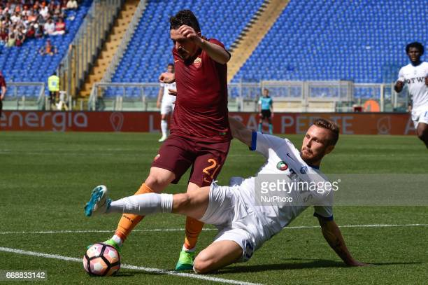 Andrea Conti of Atalanta challenges Mário Rui of AS Roma during the italian Serie A match between Roma and Atalanta at the Olympic Stadium Rome Italy...