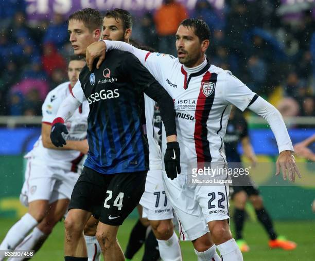 Andrea Conti of Atalanta competes for the ball with Marco Borriello of Cagliari during the Serie A match between Atalanta BC and Cagliari Calcio at...