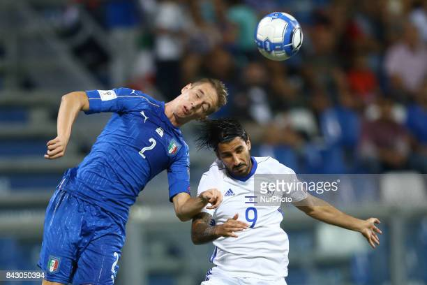 Andrea Conti of Italy and Lior Rafaelov of Israel during FIFA World Cup Qualifier Group G match between Italy and Israel at Mapei Stadium in Reggio...