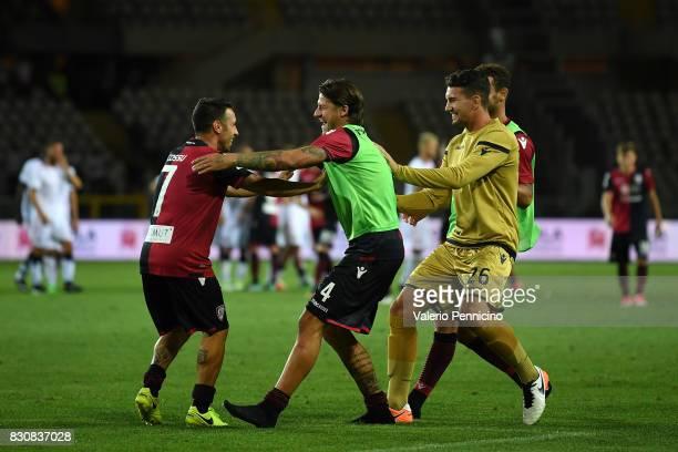 Andrea Cossu of Cagliari Calcio celebrates the victory with team mates at the end of the TIM Cup match between Cagliari Calcio and US Citta di...