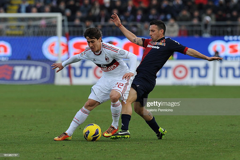 Andrea Cossu (R) of Cagliari Calcio tackles Krkic Bojan of AC Milan during the Serie A match between Cagliari Calcio and AC Milan at Stadio Is Arenas on February 10, 2013 in Cagliari, Italy.