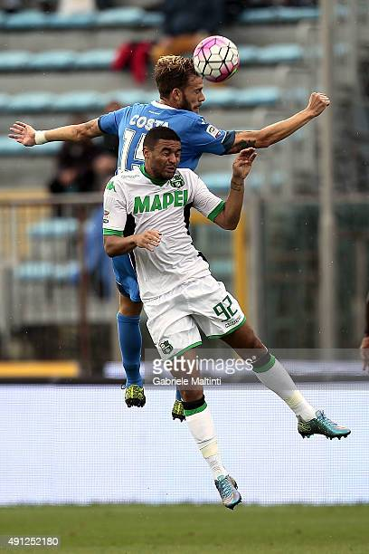 Andrea Costa of Empoli FC battles for the ball with Gregoire Defrel of US Sassuolo Calcio during the Serie A match between Empoli FC and US Sassuolo...
