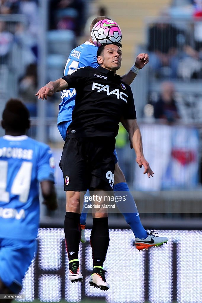Andrea Costa of Empoli FC battles for the ball with <a gi-track='captionPersonalityLinkClicked' href=/galleries/search?phrase=Sergio+Floccari&family=editorial&specificpeople=675401 ng-click='$event.stopPropagation()'>Sergio Floccari</a> of Bologna Fc during the Serie A match between Empoli FC and Bologna FC at Stadio Carlo Castellani on May 1, 2016 in Empoli, Italy.