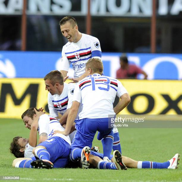 Andrea Costa of UC Sampdoria celebrates with teammates after scoring the winning goal during the Serie A match between AC Milan and UC Sampdoria at...