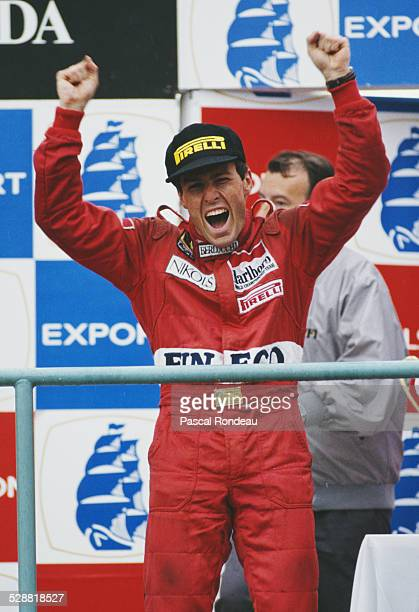 Andrea de Cesaris of Italy driver for the BMS Scuderia Italia Dallara F189 Ford DFR team celebrates his third place during the Canadian Grand Prix on...