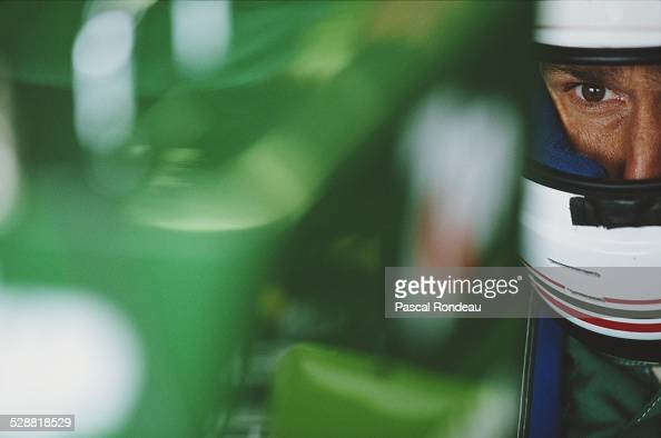 Andrea de Cesaris of Italy driver of the Team 7UP Jordan Jordan 191 Ford HB4 V8 checks the lap times during practice for the British Grand Prix on...