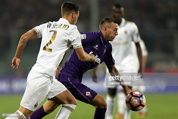 Andrea De Ciglio of ACF Fiorentina fights for the ball with Federico Bernardeschi of AC Milan during the Serie A match between ACF Fiorentina and AC...