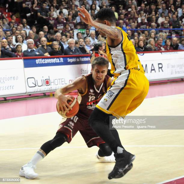 Andrea De Nicolao of Umana competes with Lamar Patterson of Fiat during the LBA LegaBasket of Serie A match between Reyer Umana Venezia and Auxilium...