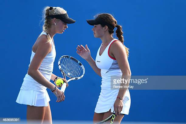 Andrea Dikosavljevic of Australia and Lyann Hoang of Australia talk tactics in their first round doubles match against Fanny Stollar of Hungary and...
