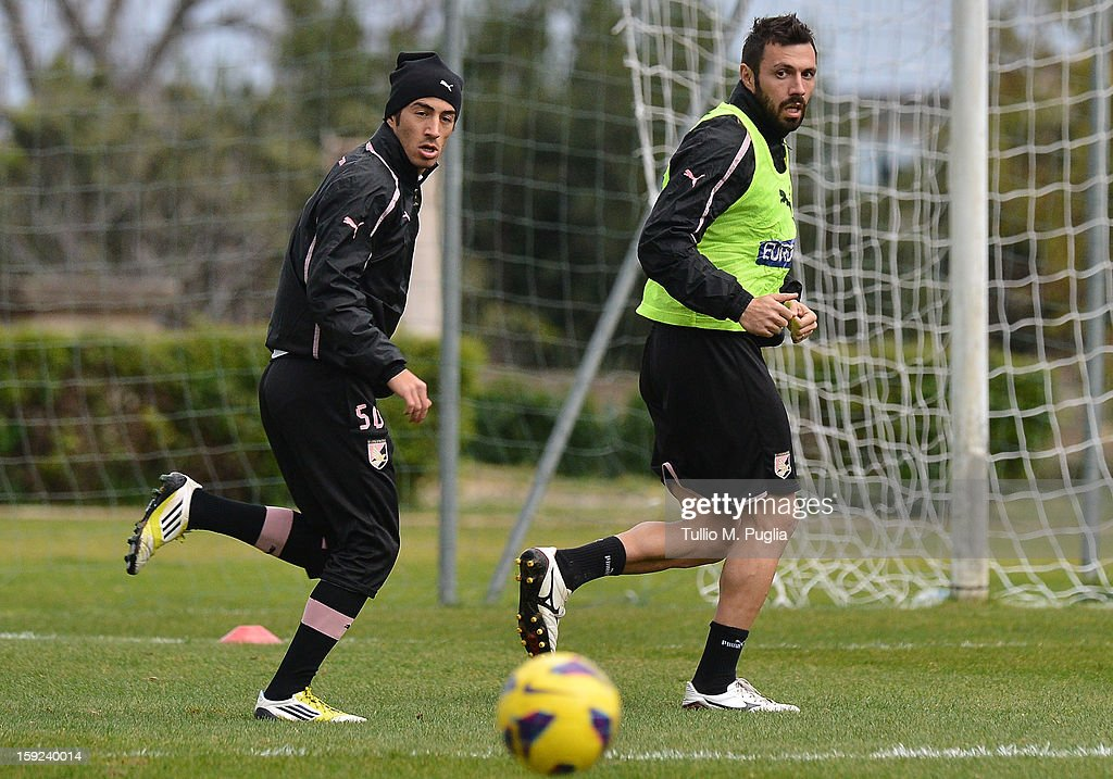 Andrea Dossena (R) of Palermo and and his team-mate Giulio Sanseverino in action during a training session at Tenente Carmelo Onorato Sports Center on January 10, 2013 in Palermo, Italy.