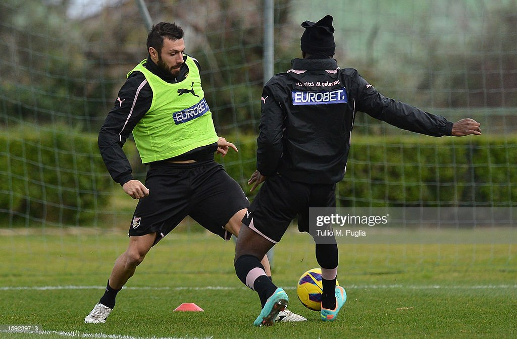 <a gi-track='captionPersonalityLinkClicked' href=/galleries/search?phrase=Andrea+Dossena&family=editorial&specificpeople=709826 ng-click='$event.stopPropagation()'>Andrea Dossena</a> (L) of Palermo in action during a training session at Tenente Carmelo Onorato Sports Center on January 10, 2013 in Palermo, Italy.