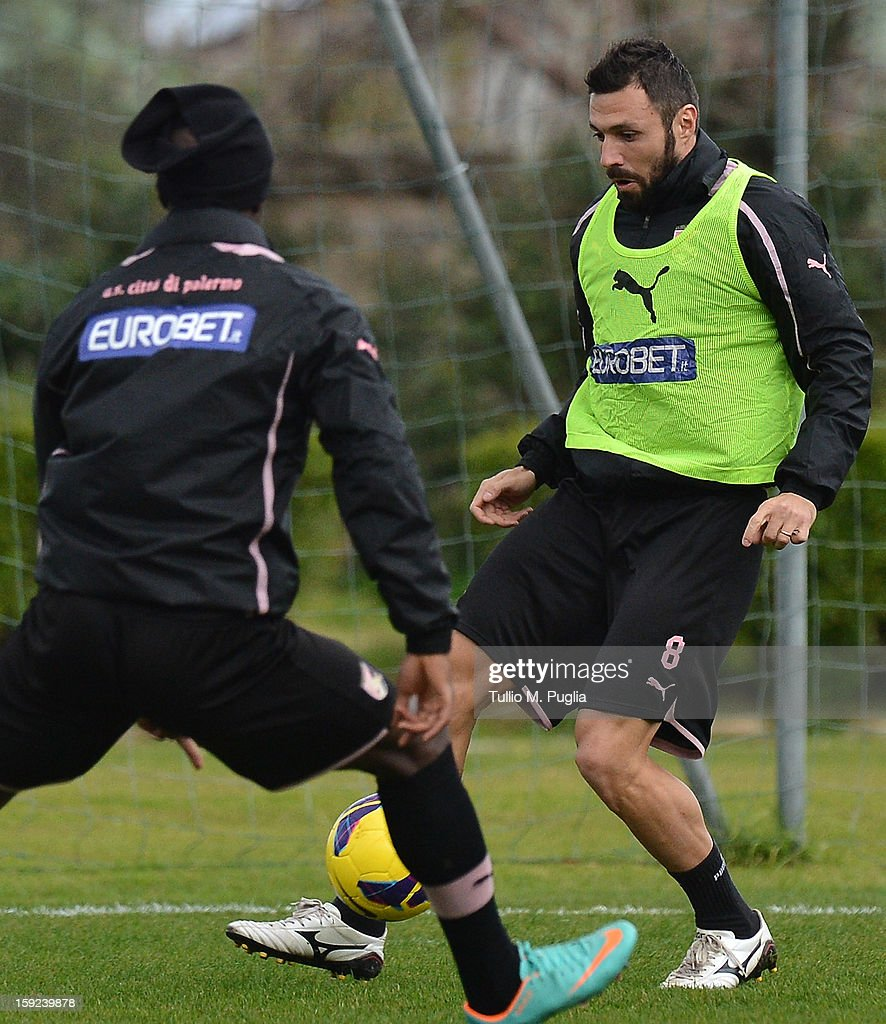 Andrea Dossena (R) of Palermo in action during a training session at Tenente Carmelo Onorato Sports Center on January 10, 2013 in Palermo, Italy.