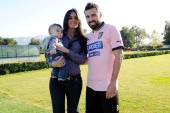 Andrea Dossena of Palermo poses with his wife and son wearing his new team shirt before his presentation as new player of US Citta di Palermo at...