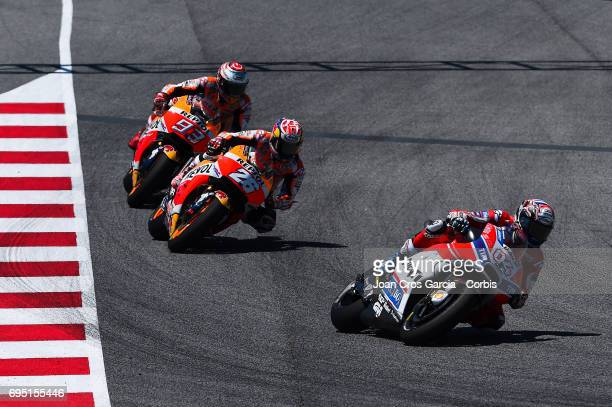 Andrea Dovizioso of Ducati Team and Dani Pedrosa and Marc Marquez of Repsol Honda Team riding his bikes during the Moto GP race Moto GP of Catalunya...