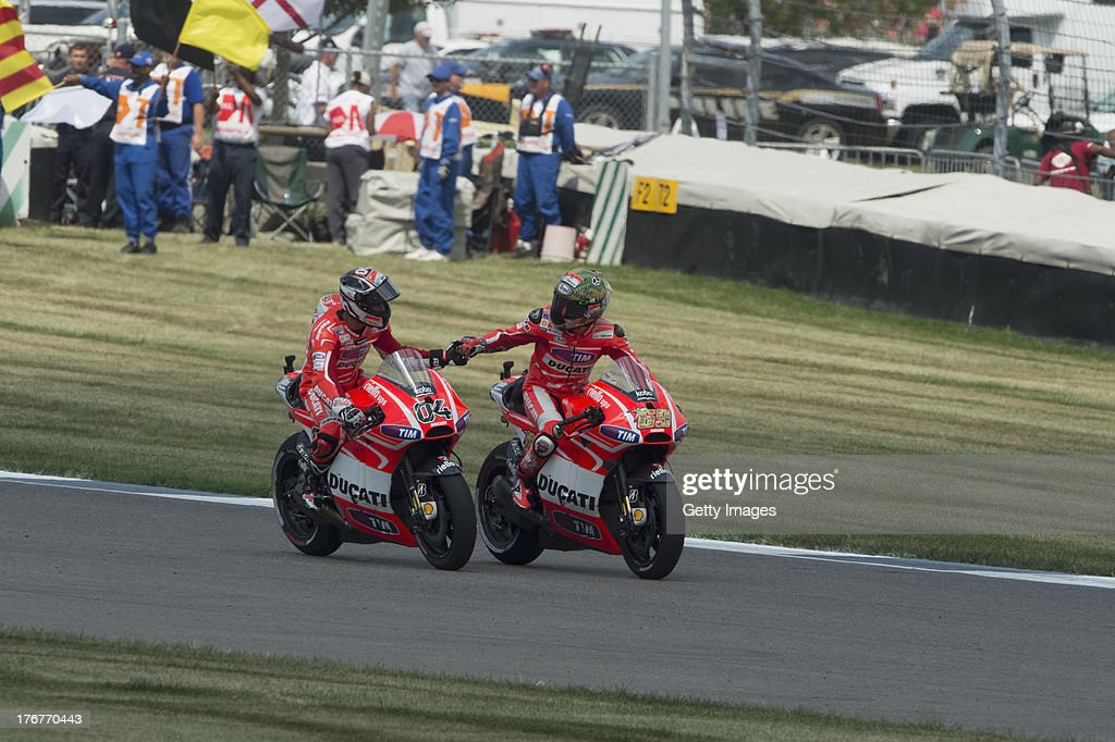 Andrea Dovizioso of Italy and Ducati Marlboro Team greets Nicky Hayden of USA and Ducati Marlboro Team (L) at the end of the MotoGP race during the MotoGp Red Bull U.S. Indianapolis Grand Prix - Race at Indianapolis Motor Speedway on August 18, 2013 in Indianapolis, Indiana.