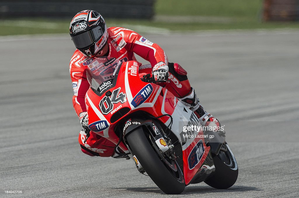 <a gi-track='captionPersonalityLinkClicked' href=/galleries/search?phrase=Andrea+Dovizioso&family=editorial&specificpeople=559970 ng-click='$event.stopPropagation()'>Andrea Dovizioso</a> of Italy and Ducati Marlboro Team heads down a straight during the MotoGP Of Malaysia - Free Practice at Sepang Circuit on October 11, 2013 in Kuala Lumpur, Malaysia.