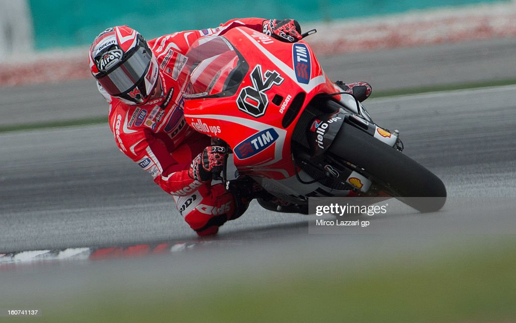 <a gi-track='captionPersonalityLinkClicked' href=/galleries/search?phrase=Andrea+Dovizioso&family=editorial&specificpeople=559970 ng-click='$event.stopPropagation()'>Andrea Dovizioso</a> of Italy and Ducati Marlboro Team rounds the bend during the MotoGP Tests in Sepang - Day Three at Sepang Circuit on February 5, 2013 in Kuala Lumpur, Malaysia.