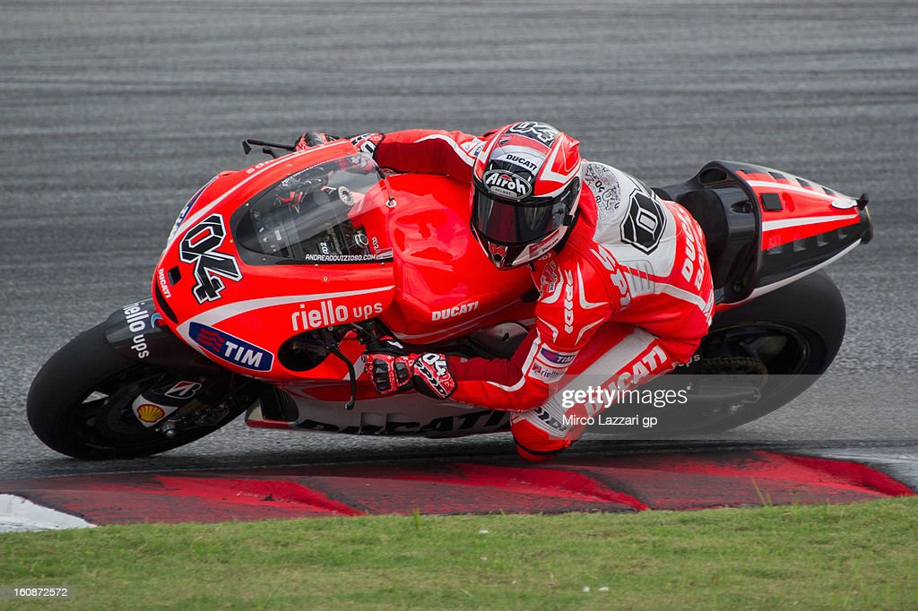 <a gi-track='captionPersonalityLinkClicked' href=/galleries/search?phrase=Andrea+Dovizioso&family=editorial&specificpeople=559970 ng-click='$event.stopPropagation()'>Andrea Dovizioso</a> of Italy and Ducati Marlboro Team rounds the bend during the MotoGP Tests in Sepang - Day Five at Sepang Circuit on February 7, 2013 in Kuala Lumpur, Malaysia.