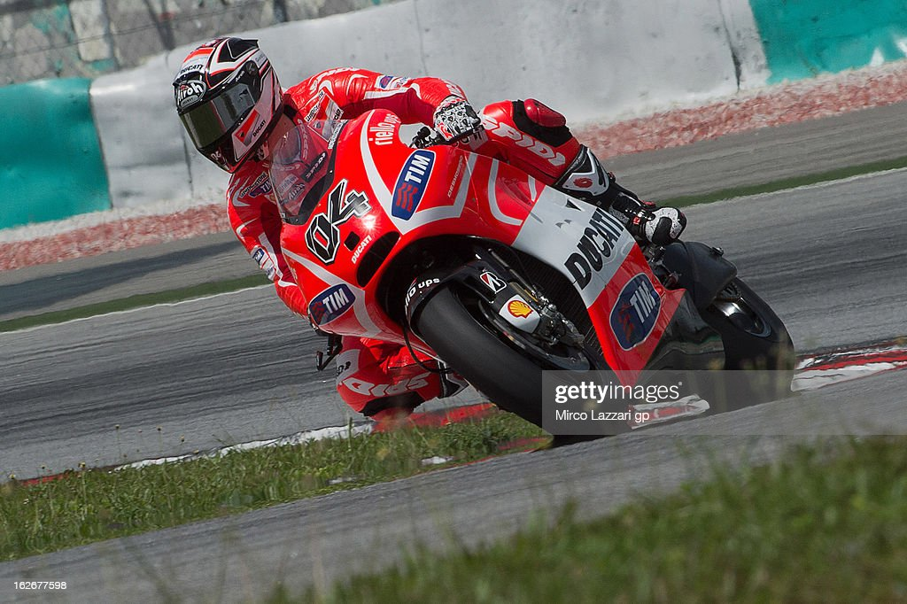<a gi-track='captionPersonalityLinkClicked' href=/galleries/search?phrase=Andrea+Dovizioso&family=editorial&specificpeople=559970 ng-click='$event.stopPropagation()'>Andrea Dovizioso</a> of Italy and Ducati Marlboro Team rounds the bend during day one of MotoGP Tests at Sepang Circuit on February 26, 2013 in Kuala Lumpur, Malaysia.