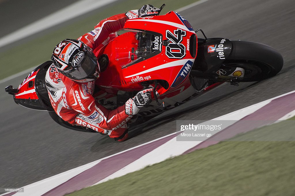 <a gi-track='captionPersonalityLinkClicked' href=/galleries/search?phrase=Andrea+Dovizioso&family=editorial&specificpeople=559970 ng-click='$event.stopPropagation()'>Andrea Dovizioso</a> of Italy and Ducati Marlboro Team rounds the bend during the MotoGp of Qatar - Qualifying at Losail Circuit on April 6, 2013 in Doha, Qatar.