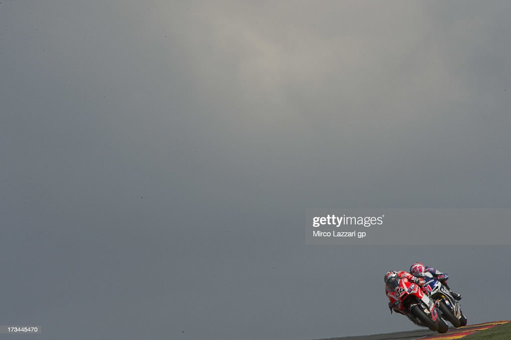 <a gi-track='captionPersonalityLinkClicked' href=/galleries/search?phrase=Andrea+Dovizioso&family=editorial&specificpeople=559970 ng-click='$event.stopPropagation()'>Andrea Dovizioso</a> of Italy and Ducati Marlboro Team rounds the bend the MotoGP race during the MotoGp of Germany - Race at Sachsenring Circuit on July 14, 2013 in Hohenstein-Ernstthal, Germany.