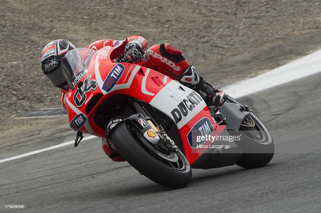 Andrea Dovizioso of Italy and Ducati Marlboro Team rounds the bend during the MotoGp Red Bull U.S. Grand Prix - Free Practice at Mazda Raceway Laguna Seca on July 19, 2013 in Monterey, California.