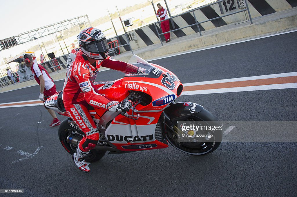 <a gi-track='captionPersonalityLinkClicked' href=/galleries/search?phrase=Andrea+Dovizioso&family=editorial&specificpeople=559970 ng-click='$event.stopPropagation()'>Andrea Dovizioso</a> of Italy and Ducati Marlboro Team starts from box during the MotoGP Tests in Valencia - Day 2 at Ricardo Tormo Circuit on November 12, 2013 in Valencia, Spain.