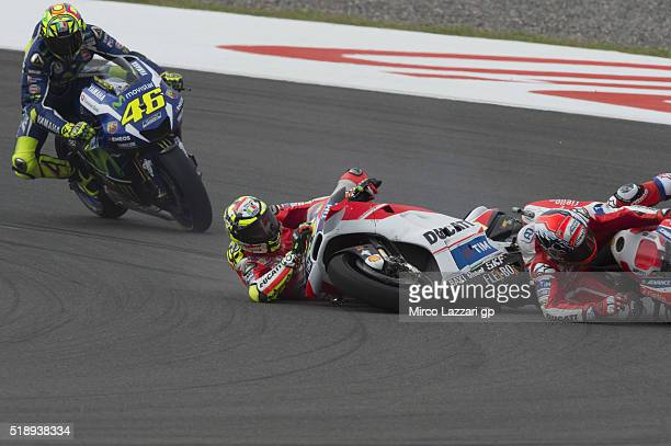 Andrea Dovizioso of Italy and Ducati Team and Andrea Iannone of Italy and Ducati Team crashed out during the MotoGP Race during the MotoGp of...