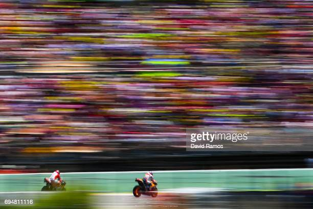 Andrea Dovizioso of Italy and Ducati Team and Marc Marquez of Spain and Repsol Honda Team ride during the MotoGp of Catalunya at Circuit de Catalunya...