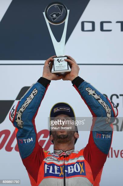 Andrea Dovizioso of Italy and Ducati Team celebates after winning the MotoGP of Great Britain at Silverstone Circuit on August 27 2017 in Northampton...