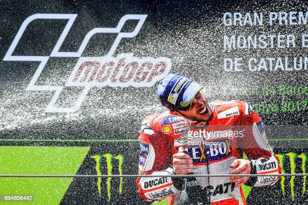 Andrea Dovizioso of Italy and Ducati Team celebrates on the podium after winning the MotoGp of Catalunya at Circuit de Catalunya on June 11 2017 in...