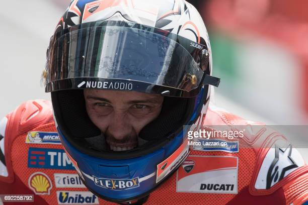 Andrea Dovizioso of Italy and Ducati Team celebrates the victory at the end of the MotoGP race during the MotoGp of Italy Race at Mugello Circuit on...