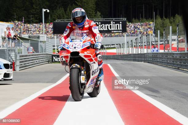 Andrea Dovizioso of Italy and Ducati Team celebrates the victory at the end of the MotoGP race during the MotoGp of Austria Race at Red Bull Ring on...